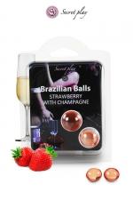 2 Brazillian balls - fraise & champagne : La chaleur du corps transforme la brazilian ball en liquide glissant au parfum fraise & champagne, votre imagination s'en trouve exacerbée.